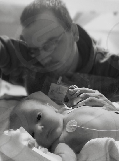 Newborn fathers love father and daughter NICUHope Faith LoveHospital  photo