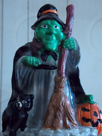 green brown gray black and orange witch figurine photo
