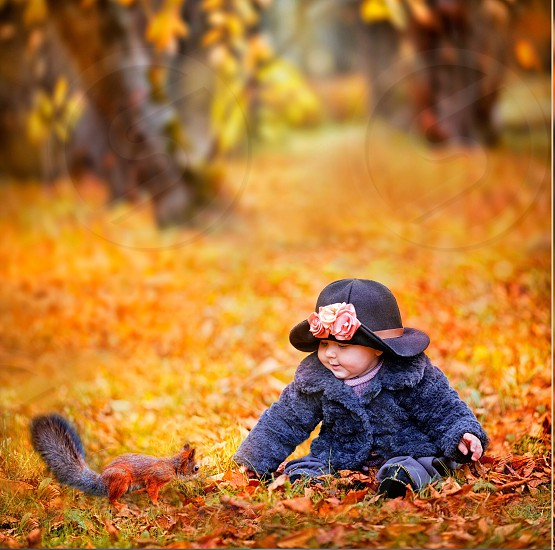 Girl little child childhood  spring summer sunset sunrise sun nature  flowers autumn orange animals park baby squirrel red fall foliage yellow people portrait coat grass outdoor photo