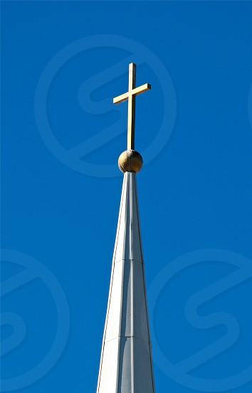 cross on steeple of building photo