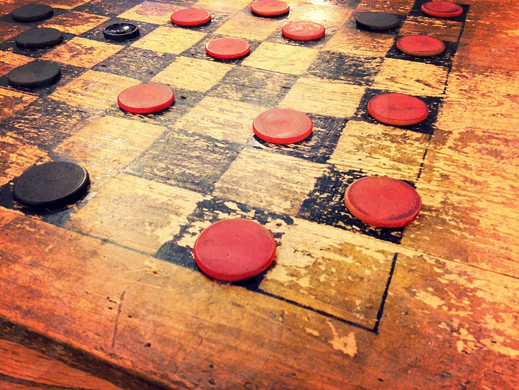 Antique and well played checkerboard in a General Store in Stowe Vermont photo