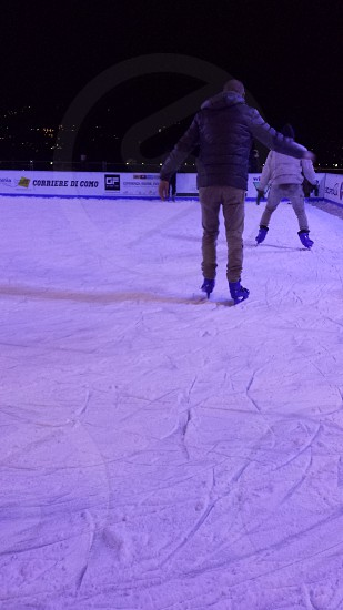 two person skating on ice skate rings photo