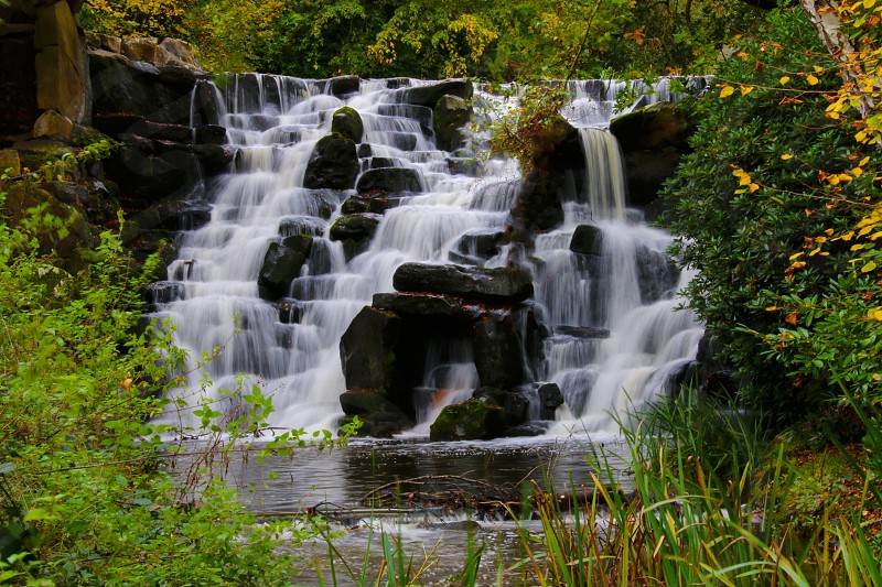 waterfalls on green grass photo
