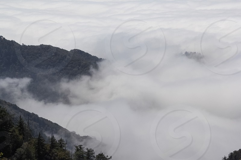 black mountains and fog photo