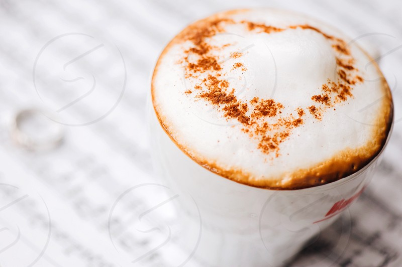 cappucino in white ceramic cup with chocolate dust photo
