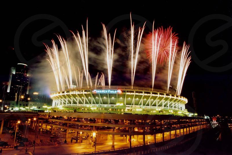 Best shot stadium fireworks pyrotechnics colorful night long exposure.   photo