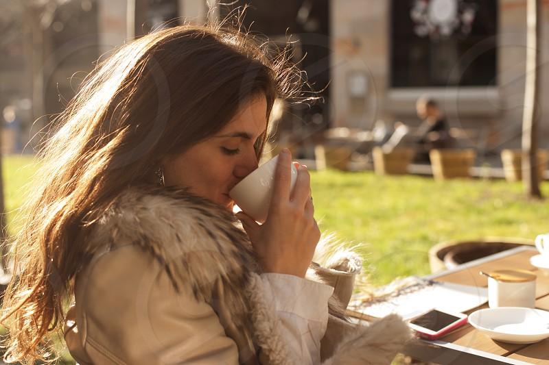 Young woman enjoying coffee photo