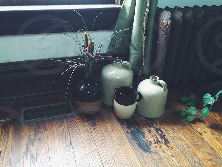 four ceramic vases on side wall photo