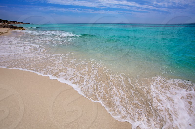 Formentera es Mitjorn beach of white sand and turquoise water at Balearic Islands photo