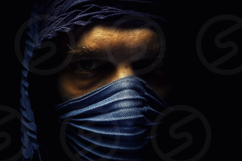 Portrait of a man wearing blue cloth details of an eyes.  photo