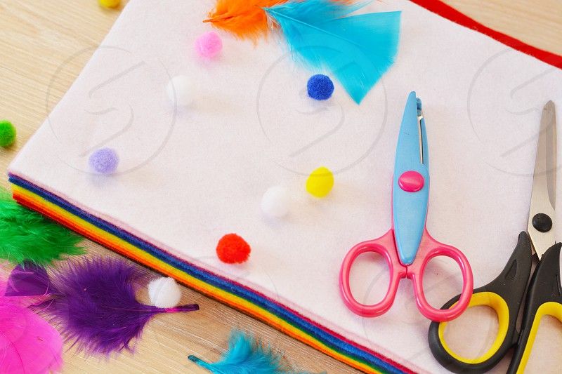 Material for making handicrafts felt  pompoms  feathers  scissors photo