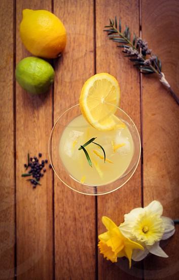 Gin daffodils lemon cocktail juniper pepper photo