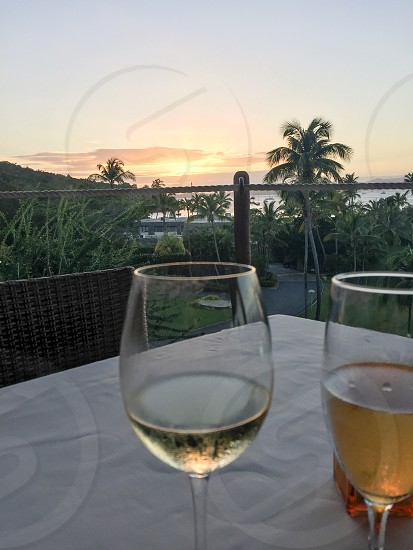 Toast sunset island vacation travel dinner champagne wine food eat love photo