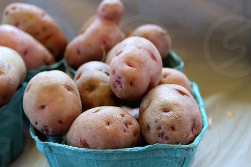 New potatoes in carton photo