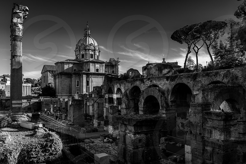 Photo taken in the famous ruins of the Roman Forum in Rome Italy. photo