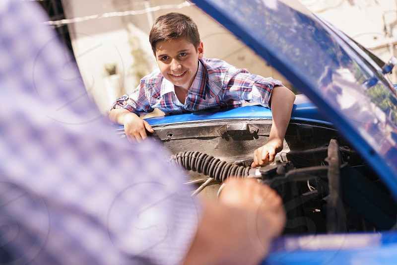 boy repair car motor grandfather grandpa engine adjusting american auto automobile broken cheerful child collaboration cooperation elderly enjoy family fix fun generation gap grandchild grandson happy hispanic hobby kid learning man old people retired retirement seniors smiling teaching team teamwork together tool two vehicle vintage wrench yard young photo