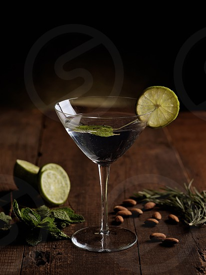 gin martini with lime mint and herbs photo