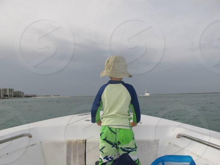 boy in speed boat photo