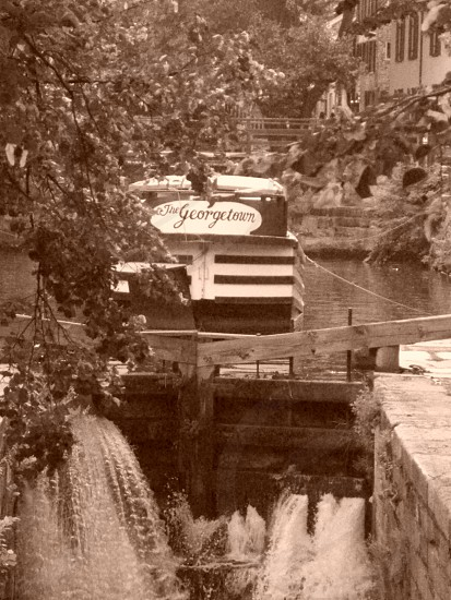 grayscale photography of The George Town boat on body of water photo