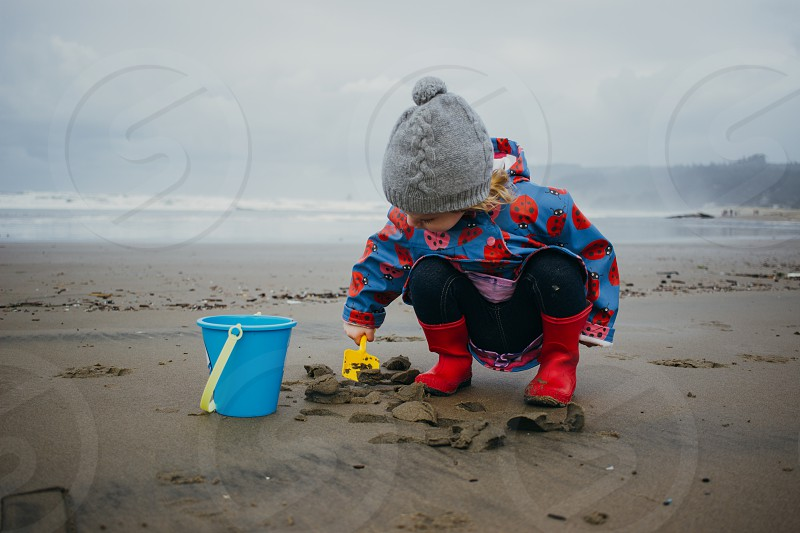 Little girl on a winter beach  photo
