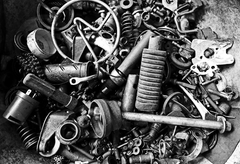 tools	 black and white	 shop	 mechanic workshop	 group	 pile	 close up	 scraps metal	 random	 abstract	 creative photo