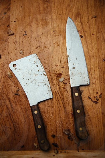 Knives on chopping board. photo