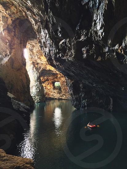 Exploring a massive quartz cave photo