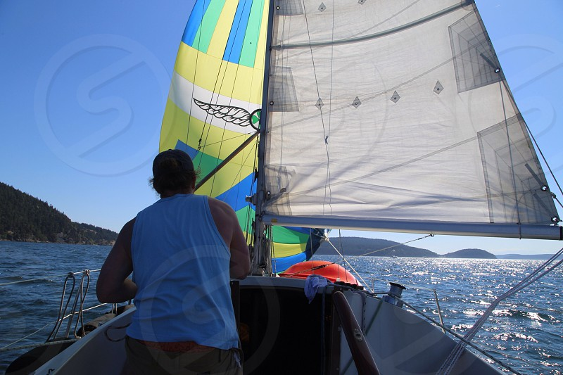 Sailor raising the spinnaker in the PNW... photo