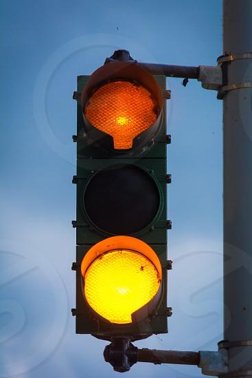 storm clouds stop light traffic red orange yellow simple minimal photo