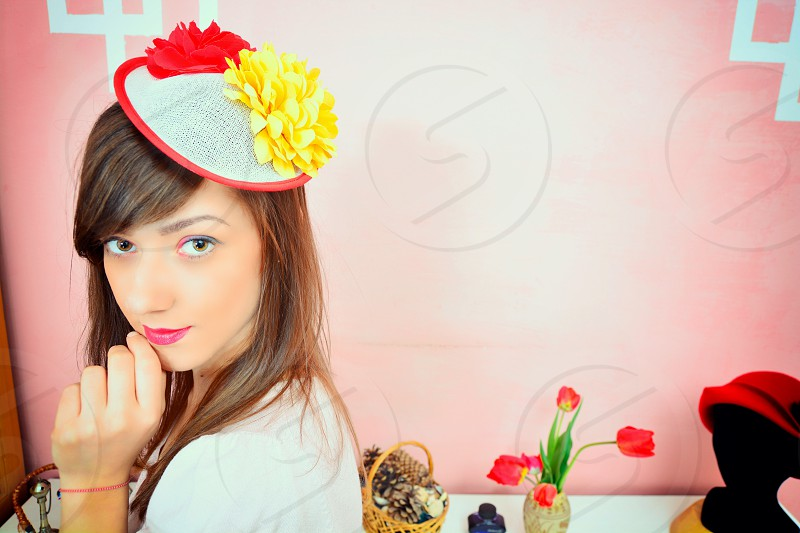 woman wearing white hat with yellow flower accent photo