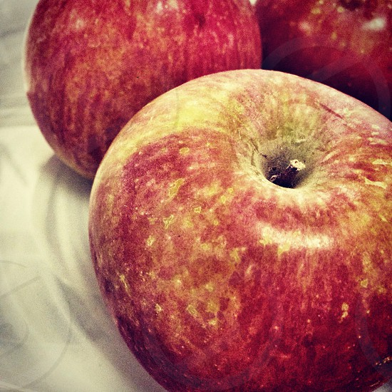 three red round apples photo
