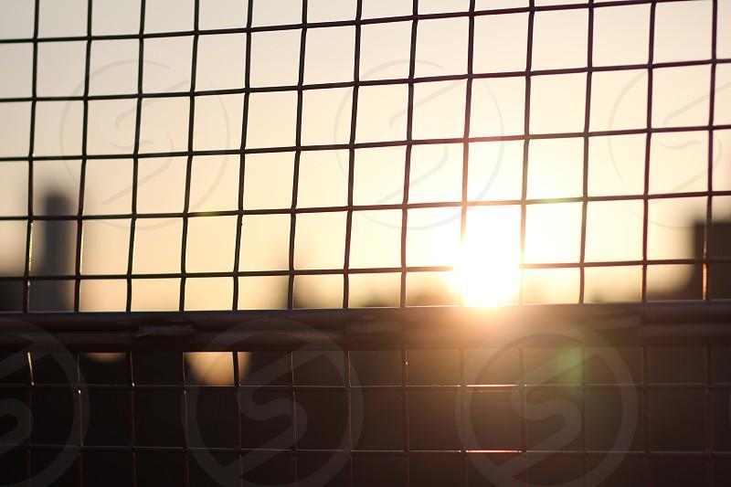 light through gate williamsburg bridge bridge new york nyc new york city manhattan city sunrise sunset hope sunshine sun city urban landscape metal fence cityscape sunlight brooklyn photo