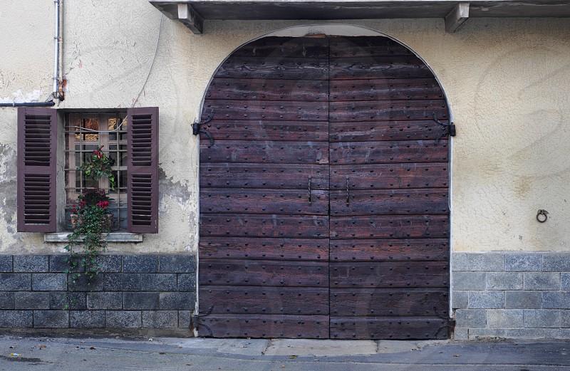 an Italian garage door with window photo