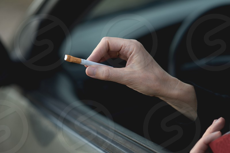 human hand with cigarette  photo