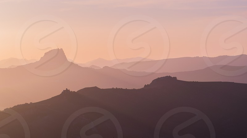 Lights and shadows. panorama of the hills in the Sicilian hinterland seen at sunset. photo