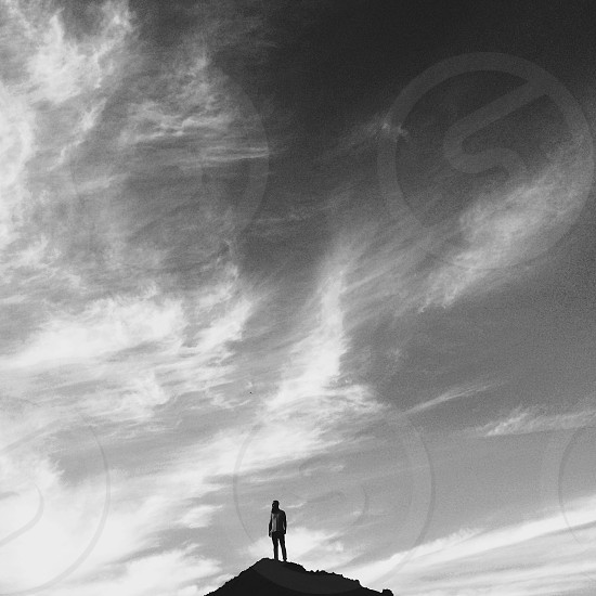 man standing on top of mountain photo