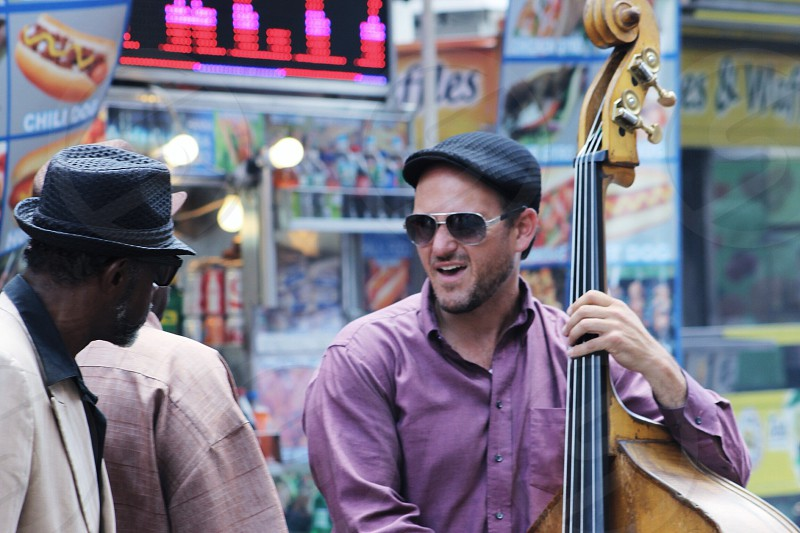 man in purple formal shirt holding cello photo