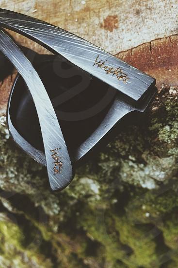 Woodroze® sunglasses on a mossy stump. photo
