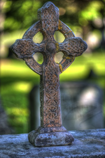 Decorative Cross in a cemetery with great bokeh photo