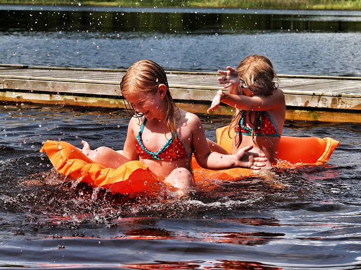 To play with the kids in the water or just to se them play and having fun makes me happy photo