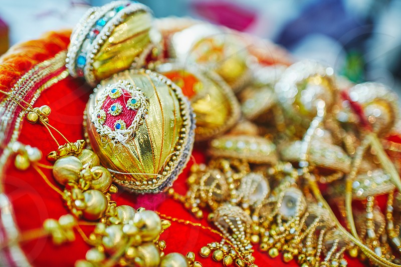 Selective focus with narrow depth of field of coconut decoration in gold (Shagun Nariyal) The ritual items for Indian wedding ceremony photo