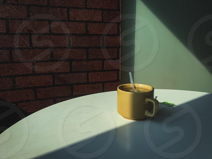 Coffeecupdrinkmugcontainersunlightshadowinteriortablerestaurantfooddinebreakfast  photo