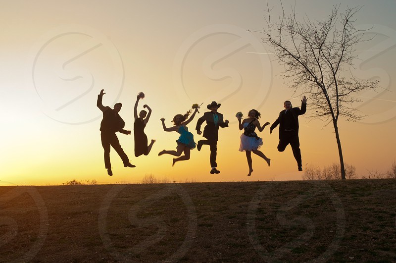 6 persons jumping photo