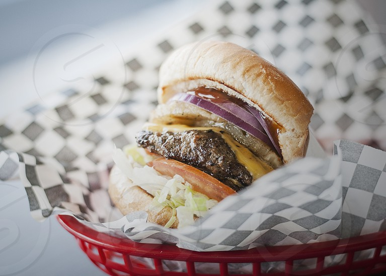burger cheese cheeseburger diner dinner bread meat bun onion lettuce tomato shredded basket checkered  photo