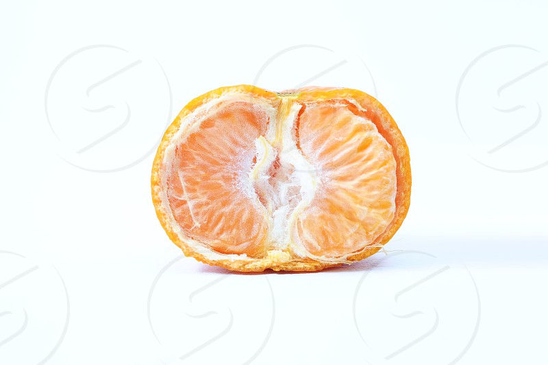 Fresh half cut orange front view isolated in white background photo
