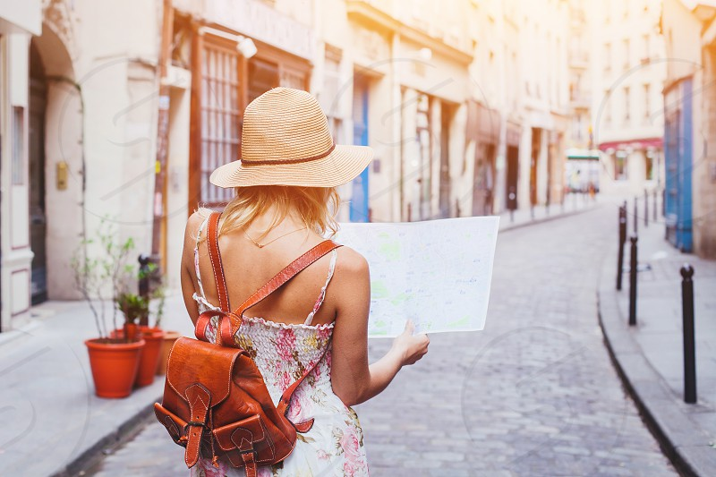 woman tourist looking at the map on the street of european city travel to Europe photo