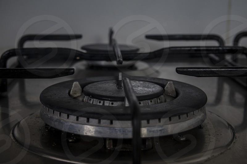 Gas stove in the kitchen - Dark closeup. photo