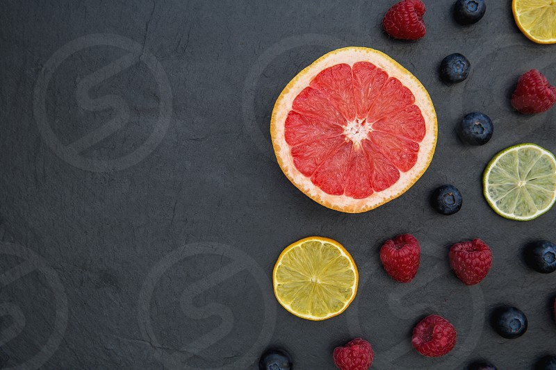 Fruit selection on dark food background with copy space photo