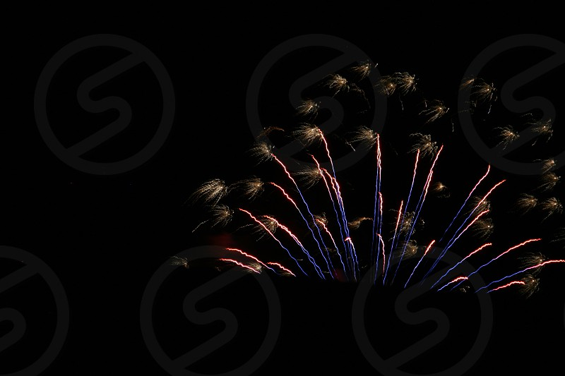 yellow purple blue fireworks photo