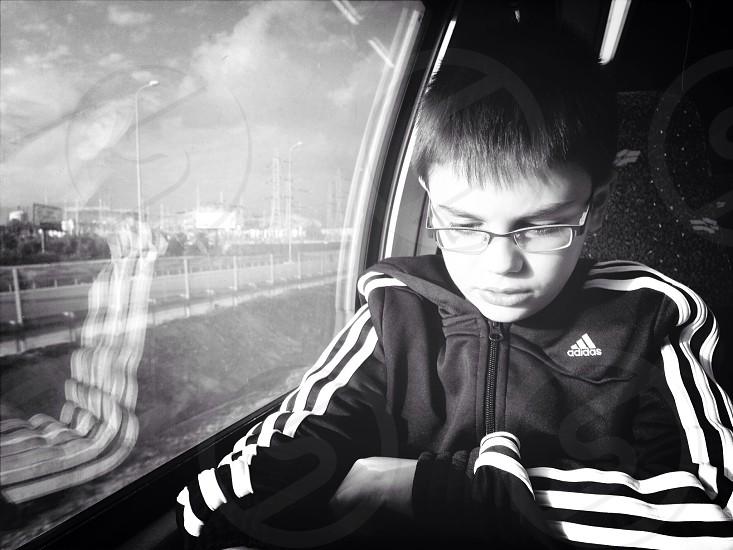 boy in adidas zip up hoodie inside car photo